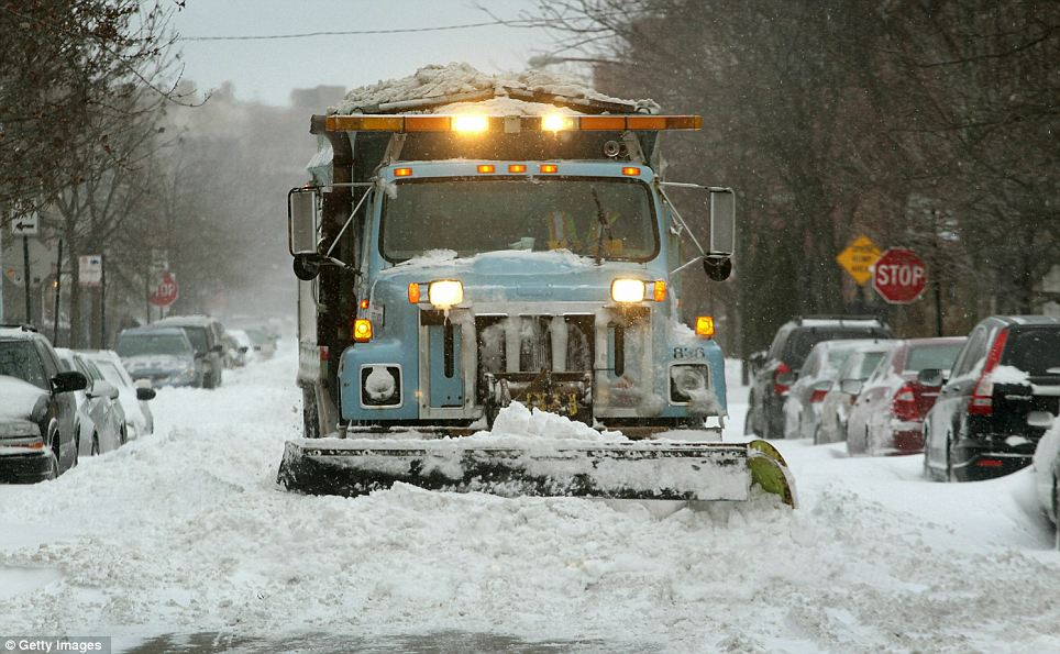Coming through: A snowplough clears a street in a suburban area of Chicago