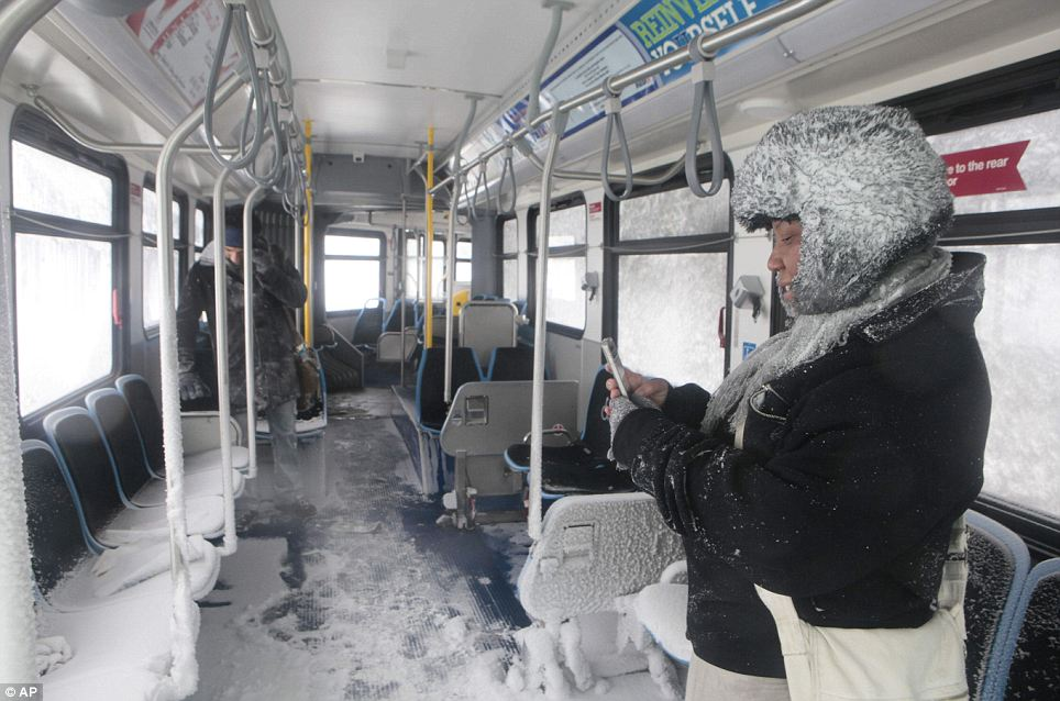 Eileen Black takes pictures inside of a Chicago Transit bus that was stranded overnight. The blizzard  caused havoc in a city well used to dealing with big snowfalls 