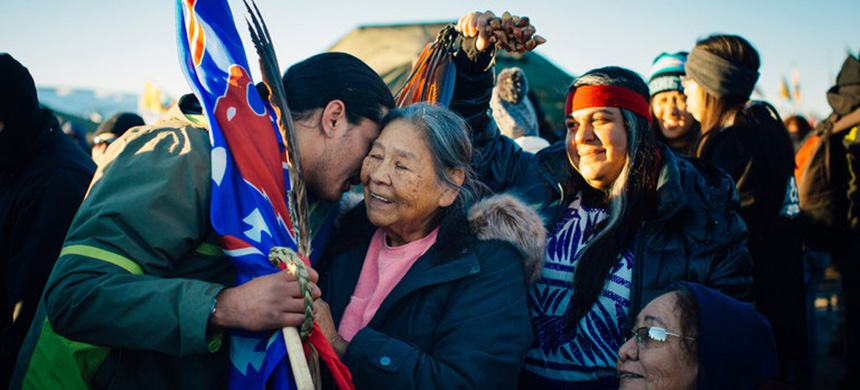Protesters celebrated after learning that the Army said it would not allow an oil pipeline to be drilled near the Standing Rock Sioux reservation. (photo: Alyssa Schukar/NYT)