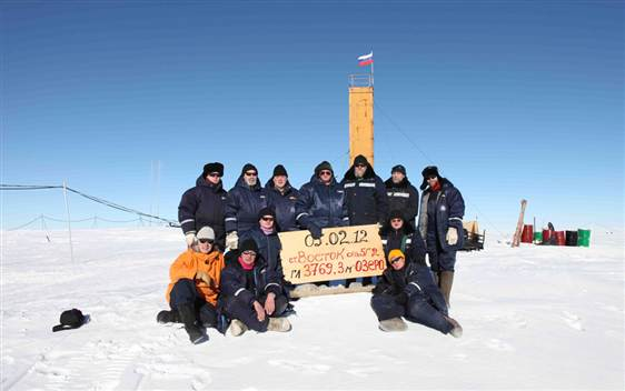 Image: Russian researchers at the Vostok station in Antarctica pose for a picture after reaching subglacial lake Vostok.