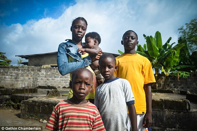 Pictured is Odell Kpaingba, 17, holding her brother Daniel, five months, next to her brothers (from left) Josiah, 5, Otis, 8 and Chancy, 15. The family are orphans after the Ebola virus claimed both their parents
